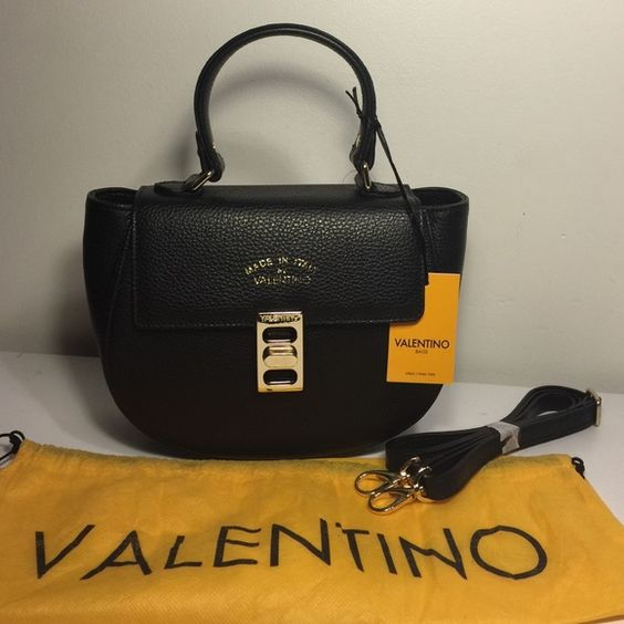 Valentino Black Flap Crossbody Authentic Valentino Black Flap Crossbody  Black tumbled leather with gold hardware Flap closure Gold adjustable closure clasp Can be carried multiple ways Top handle and removable Crossbody Zipper compartment inside Zipped closure for security   Purchased at Valentino for $995 + tax Brand new, never been used Comes with dust bag, removable straps Valentino Bags Crossbody Bags