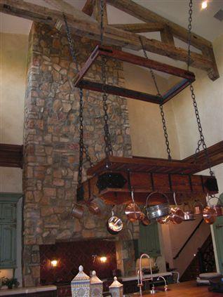 Stone covered range hood cover reclaimed wood trusses for Reclaimed wood pot rack