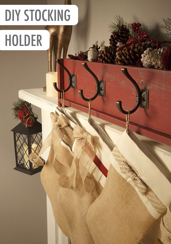Build a Rustic Stocking Holder Wooden Box and attach pretty Coat Hooks to match your style!   Tutorial via The Home Depot Blog