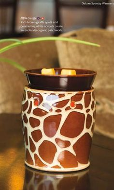 Giraffe Scentsy my favorite animal and my favorite Scentsy warmer :) if interested please let me know ill order you one :)