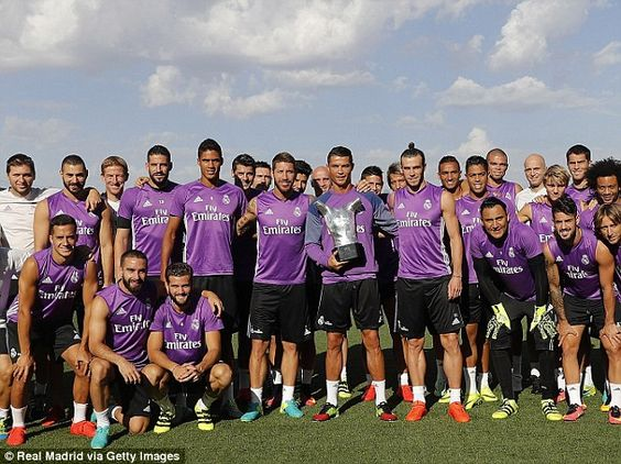 Ronaldo posed with his Real Madrid team-mates and the individual trophy he…