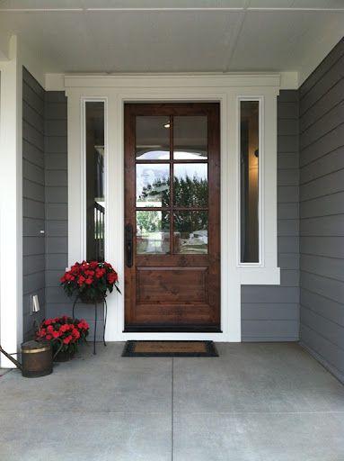 Love this front door.  Bigger side light windows, but wood or black front door with divided light windows.