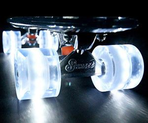 """The Sunset """"Ghost"""" (Clear Deck with White Flare LED Wheels) Unleash your sixth sense on the Light Up Sunset Skateboards Ghost. The clear, PolyCarbonate deck can flex and bend, permitting you to cruise past the crowds unseen. The clear, glow within the dark, wheel power themselves, and light-weight up at nighttime, causation chills down the viewers spine."""