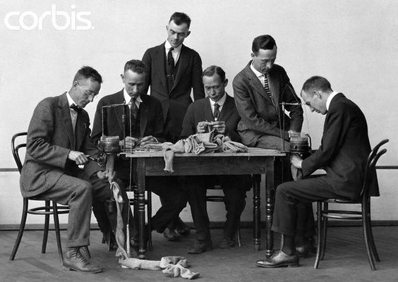 Employees at the General Electric Company knits socks and scarves for WWI soldiers.: