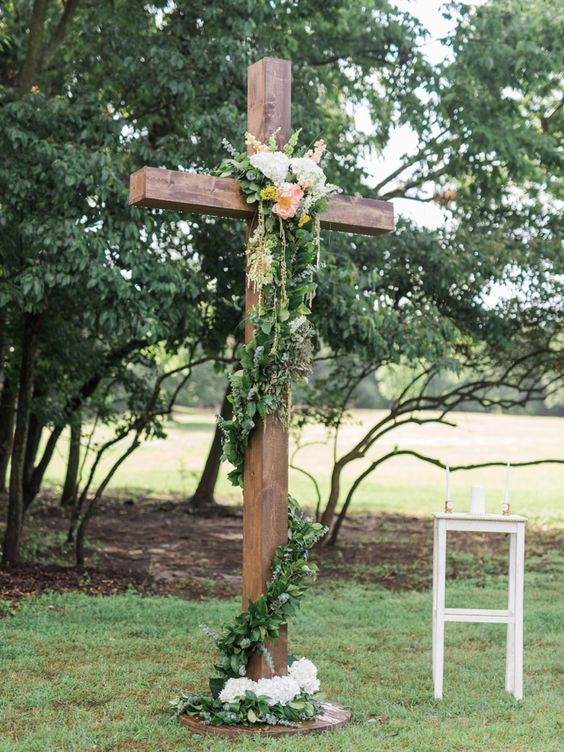 Floral adorned cross for a garden inspired wedding ceremony.