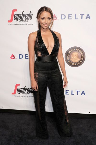 Kat Graham Jumpsuit - Kat Graham stole the spotlight in a plunging black lace-panel jumpsuit by Thai Nguyen Atelier that she paired with Kris Nations jewelry at the Friars Club event honoring Martin Scorsese.