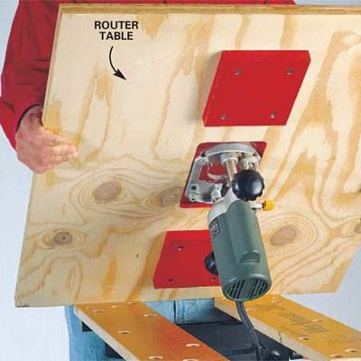 A workbench's solid base makes the perfect stand to support a homemade router tabletop (the Workmate bench is shown here). Just screw a pair of thick blocks to the base of your router table,tighten the sliding jaws to the blocks and you're ready to go. When you're finished, you can remove the table and efficiently store it flat to the wall.