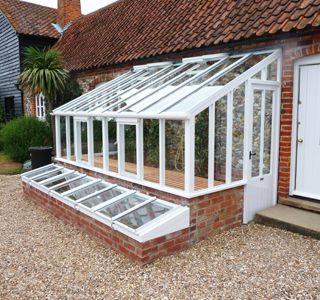 Really like this style: Edwarian mono-pitch lean-to greenhouse, front cold frames. Would like to create a similiar look using salvaged brick and windows!