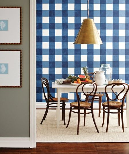 An oversize gingham wall treatment helps this dining room come to life.   Source: