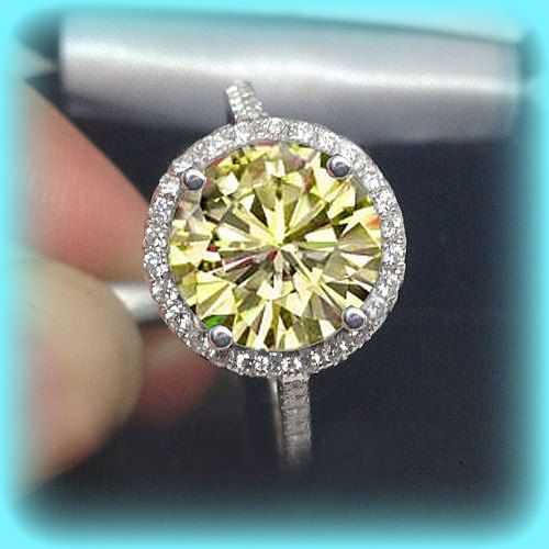 Canary Yellow Moissanite Engagement Ring. This stunning ring features a 10mm, 4ct round canary yellow moissanite set in a 14K white gold diamond halo