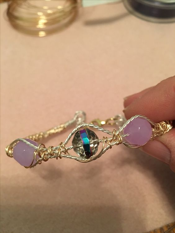 By Mary Drayer.   Something different bracelet.  Wire weaving two toned bracelet.