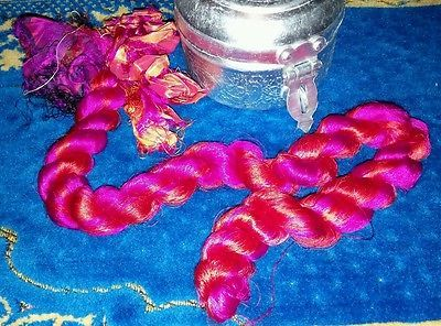 red and hot pink thrum silk for spinning art batts and rolags. measures 21.5in