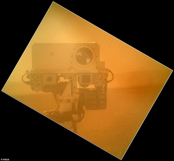 With dust cover: The Curiosity rover used a camera located on its arm to obtain this self portrait, taken before engineers removed its dust cover.