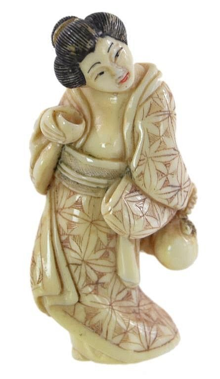 "A hand carved and polychrome scrimshawed ivory netsuke depicting an female revealing her breast. No signature found. Measures approximately 2.25"" x 1"" and weighs 18 grams"