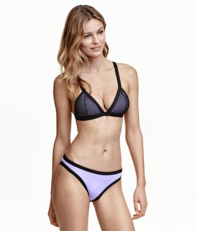 Purple. Fully lined bikini bottoms with contrasting trim. Regular waist.
