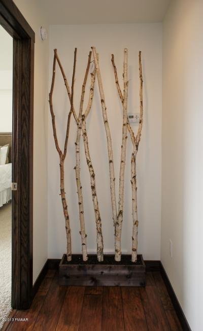 I like this idea for woodsy decoration... maybe concrete in a planter box to hold the branches in place and add weight to the bottom? Plus... minimize dirt in the house?: