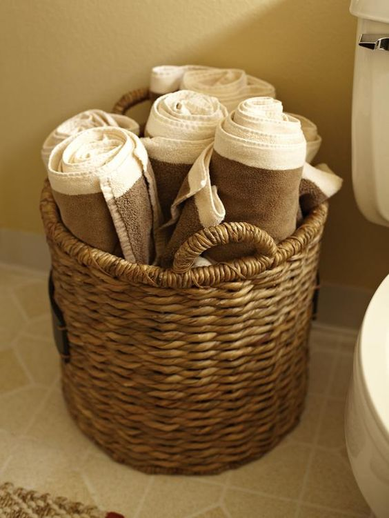 Tiny bathroom? Use a woven basket to store towels. Cute display too! >> http://www.hgtvremodels.com/interiors/beach-inspires-rental-remodel/index.html?soc=pinterest#