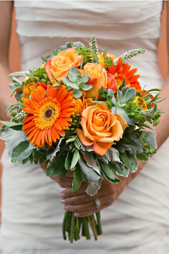 bold orange bouquet with succulents // images by Melissa Green Photography