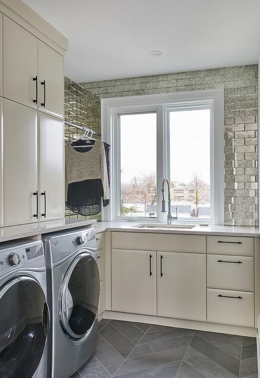 Contemporary Laundry Room Fitted With Tan Cabinets Antiqued
