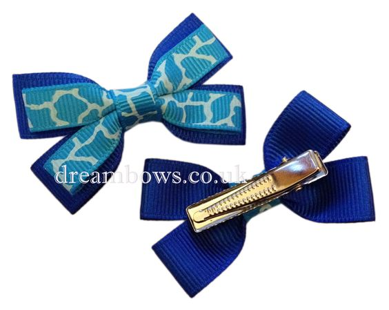 Blue animal print grosgrain ribbon hair bows on alligator clips - £2.50 a pair from www.dreambows.co.uk hairbows, blue hair bows, alligator clips, crocodile hair clips, hair bows, baby hair bows, baby bows, cute hair bows, handmade hair bows, animal print ribbon, ribbon hair bows, hair clips, hair slides