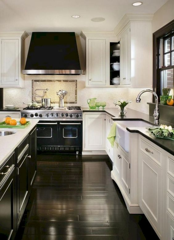 One kitchen trend that's gaining momentum as we head into the new year is white cabinets with black countertops, commonly referred to as the 'tuxedo kitchen.' Not only is the contrast of white against black dramatic and alluring, it's practical. Black countertops hide stains and smudges, while white cabinets are a timeless and functional choice for any kitchen design style.