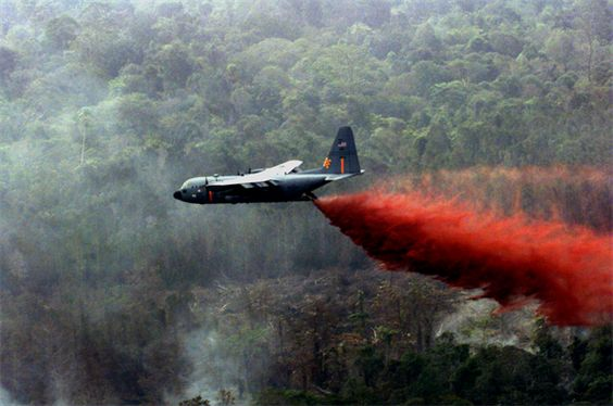 Air National Guard C-130 Hercules equipped with modular airborne firefighting systems, similar to this one, are dropping thousands of gallons of retardant on the wildfires in Southern California. (U.S. Air Force photo/Staff Sgt. Daryl McKamey) (Photo by Staff Sgt. Daryl McKamey)
