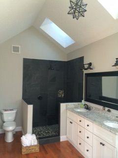 Montauk slate shower with pebble tile, blue ice granite counters, repose gray