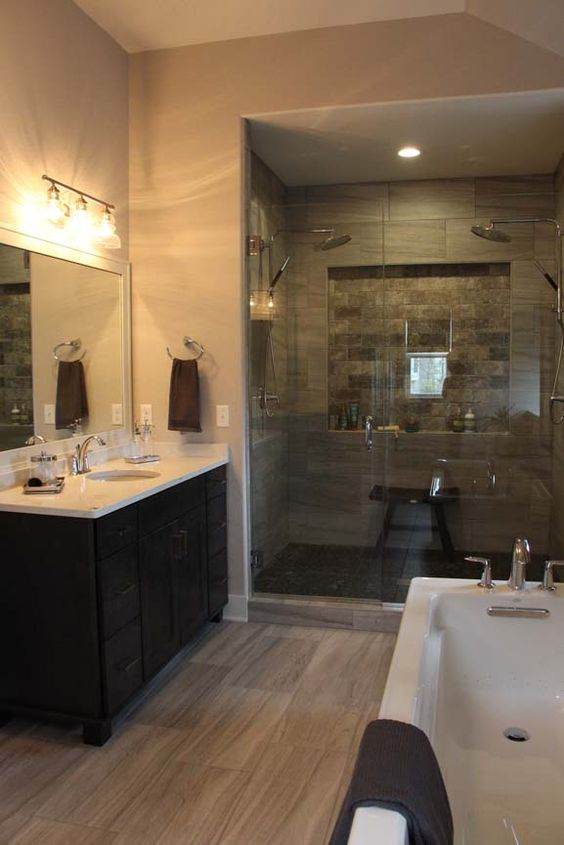 The spa like master bath includes a custom tile glass shower  Kohler free. The spa like master bath includes a custom tile glass shower