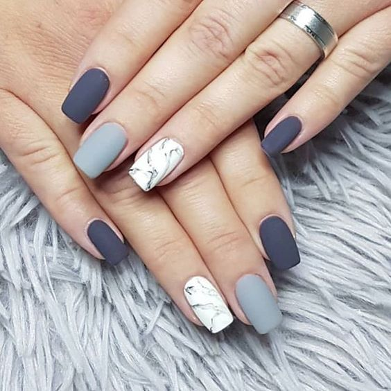 Blue hue and white marble nails