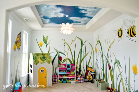 What a joyful playroom - and we love the playhouse created from a dryer box! #playroom