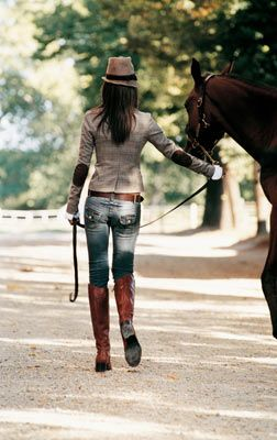 elbow patches, chic hat, and riding boots