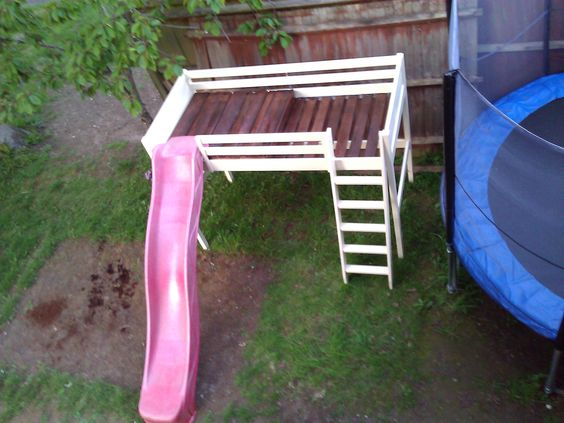 Jungle gym using an old bunk bed, slide and wooden pallet ...