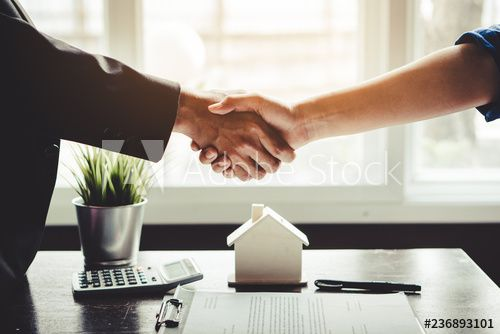The homeowner is happy after receiving the transfer of the right to occupy the home. Agent and client shaking hands after signed document and done business deal for transfer right of property. #AD , #occupy, #home, #Agent, #transfer, #homeowner