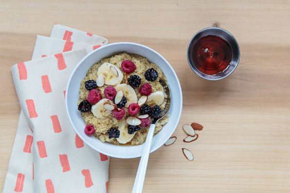 Ingredients:  2 cups almond milk, plus 1/4 for topping  1 cup quinoa, rinsed  1 big pinch sea salt  1/4 cup blackberries  1/4 cup raspberries  1 banana  1/8 cup slivered almonds  Maple syrup to taste  Optional: 1/2 tsp almond extract