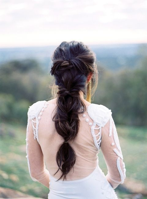 Braided and intricate hairstyle perfect for this open back gown