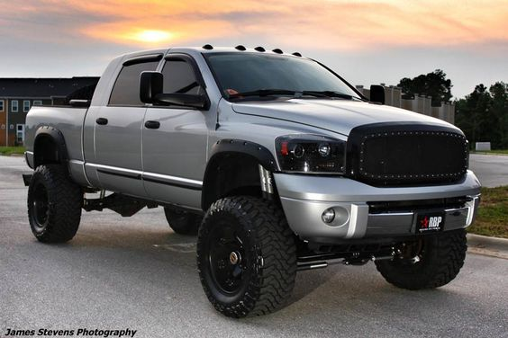 www.CustomTruckPartsInc.com is one of the largest Truck accessories retailer in Western Canada. Toll Free 1-855-868-8802. lifted silver dodge ram 2500  truck