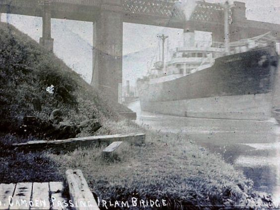 HMS Camden, passing under Irlam bridge