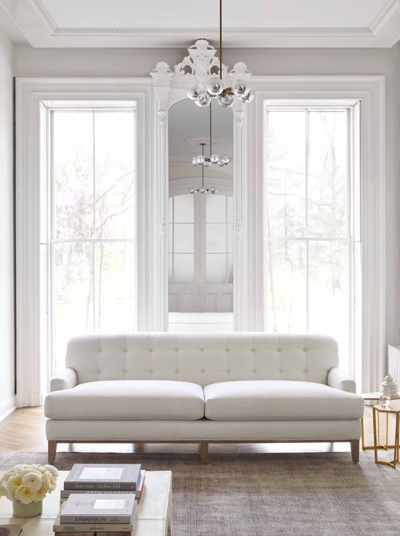 Maiden Home tufted white sofa in a living room with classic architecture. #whitelivingroom #minimaldecor