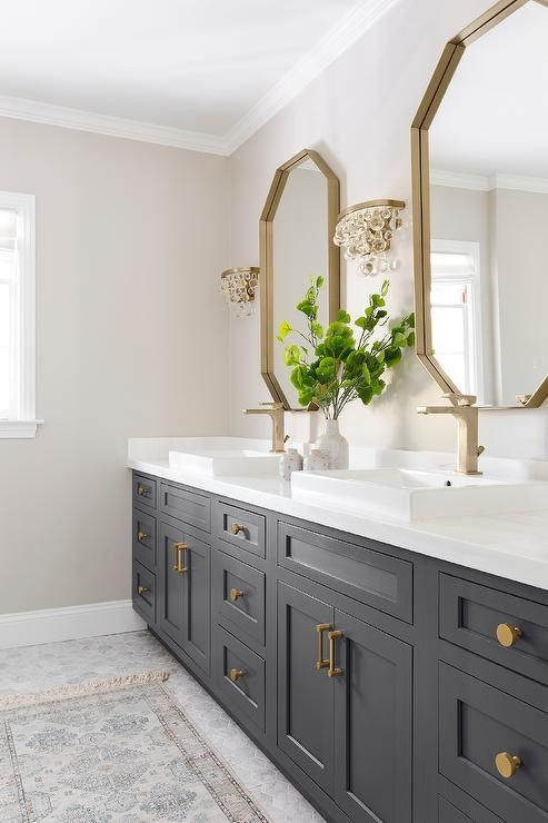 Glass Droplets Sconces Flank A Gold Mirror Over A Black Bath Vanity Accented With Brass Hard Black Vanity Bathroom Bathrooms Remodel Master Bathroom Renovation