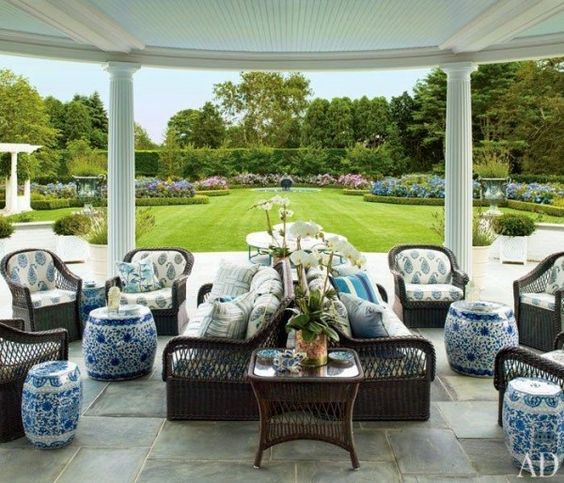Mario Buatta extended his passion for chintz onto the wicker furniture of a veranda he designed for Hilary and Wilbur Ross's bucolic setting in the Hampton's. Photo by Scott Frances.
