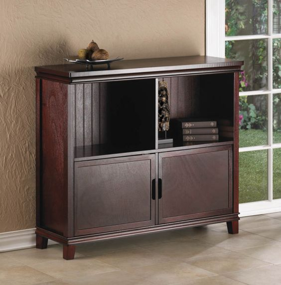 Showcase and store your treasures in this rich espresso-colored wood cabinet. Decorate the top with stylish accents and fill the two interior shelves with your favorite decor, while two doors below open to reveal the perfect storage solution for any room.