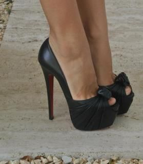 High heel, black bow. so cute!