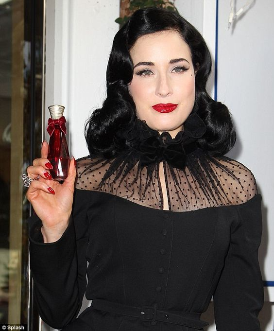 Flawless: Last Monday, the dancing sexpot attended the launch of her second fragrance, Rouge, at Fred Segal while wearing a vintage Thierry Mugler suit: