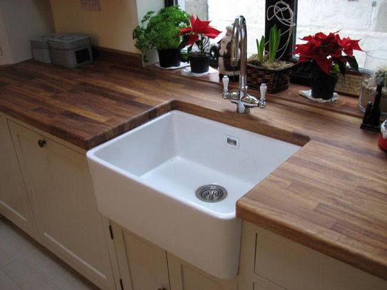 ceramic sink set in rustic oak worktop, I would absolutely love this look.