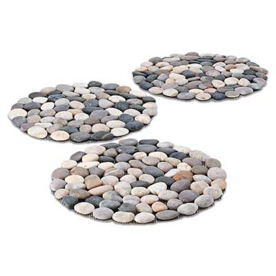Connect the dots between two areas in your yard with stylish River stepping stones. About $39 for three mesh-backed rounds from vivaterra.com.   thisoldhouse.com