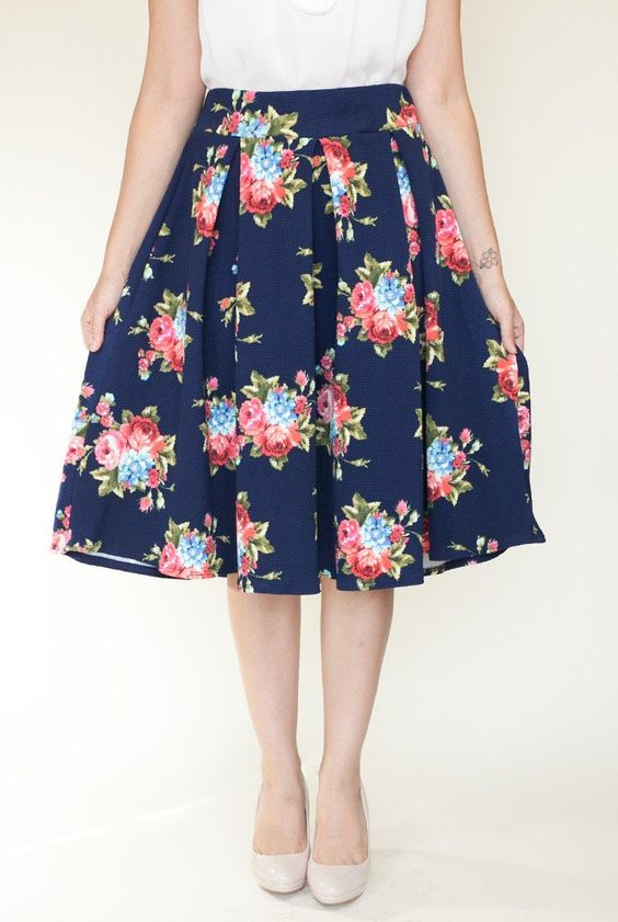 You'll feel like a lady when you stroll down the block in this navy floral skirt. It has a stretchy high-waist band that will accentuate your elegant curves.