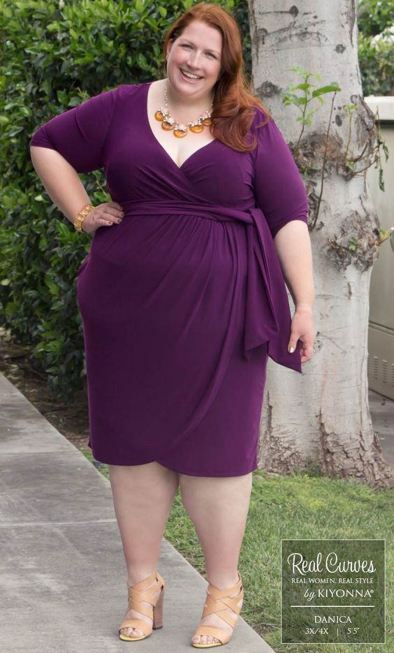 """Real Curve Cutie Danica's (5'5"""" and a size 3x/4x) beauty shines through in style with our plus size Harlow Faux Wrap Dress.  See more Real Curve Cuties at www.kiyonna.com  #KiyonnaPlusYou  #MadeintheUSA"""
