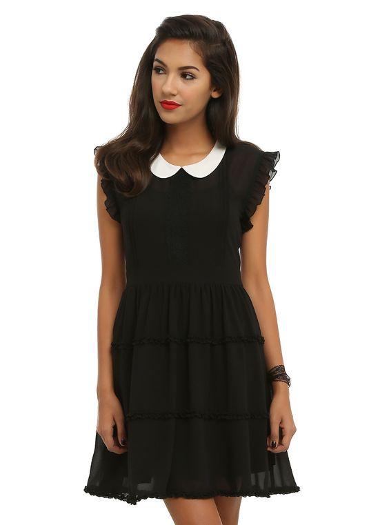 <p>Black chiffon dress with ruffle trim, white peter pan collar and attached slip.</p>  <ul> <li>100% polyester</li> <li>Wash cold; hang dry</li> <li>Imported</li> </ul>