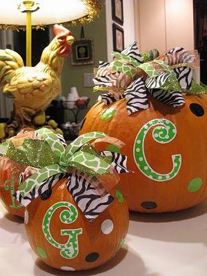 Monogrammed pumpkins with ribbon.