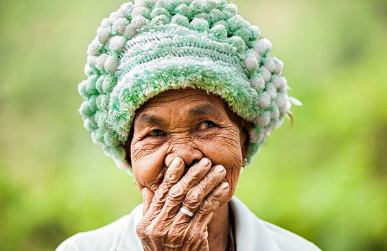 Hidden smile. Old woman from Hre minority. Photo by Réhahn Croquevielle -- National Geographic Your Shot